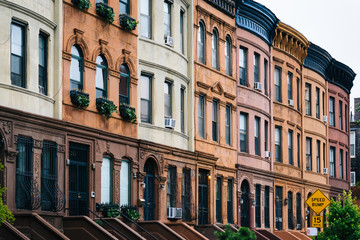 Colorful row houses in Harlem, Manhattan, New York City.
