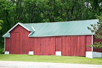 Old red wooden farm barn building for life stock.