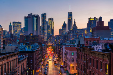 View of Madison Street and Lower Manhattan at sunset from the Manhattan Bridge in New York City Fotobehang