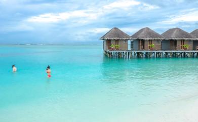 Water villa with blue ocean sea at Maldives island