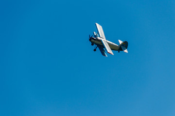 Biplane flying in blue sky