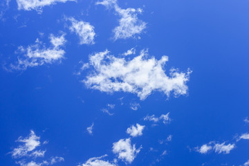 White fluffy clouds in a deep blue sky