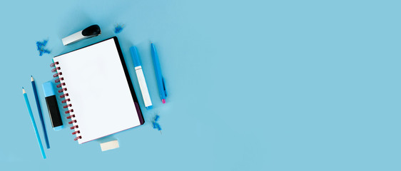 Blue background and blue school supplies. Back to school. Flat lay.  Creative Idea of education for banners. Sale posters.  Blue background with copy space.
