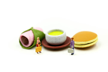 Miniature people : couple of love  with Dessert Japanese traditional confectionery,Sakura Mochi,matcha green tea,Dorayaki