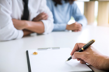 Agreement prepared by lawyer signing decree of divorce (dissolution or cancellation) of marriage, husband and wife during divorce process with male lawyer or counselor and signing of divorce contract