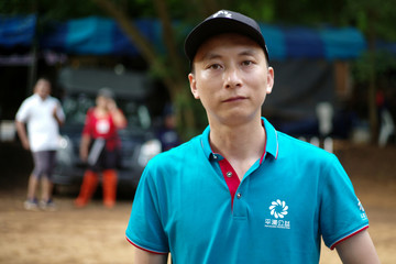 Chinese team leader, professional rescuer and diver, Wang Yingjie poses during an interview with Reuters near the Tham Luang cave complex, where 12 boys and their soccer coach are trapped, in the northern province of Chiang Rai