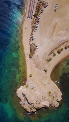 Aerial birds eye view photo taken by drone of famous rock of Kalikatsou in Petra beach, Patmos island, Dodecanese, Greece