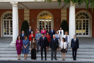 Spain's Prime Minister Pedro Sanchez and cabinet ministers pose for a family photo before their cabinet meeting at the Moncloa Palace in Madrid