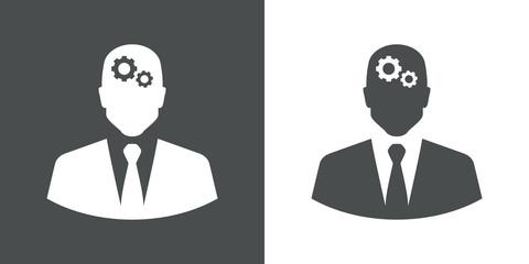 Icono plano hombre de negocios y engranajes en gris y blanco