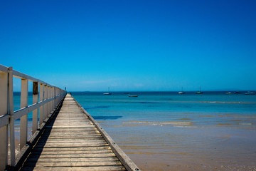 wooden pier on a beach seascape