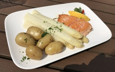 Salmon steak with fresh asparagus and potato Germany