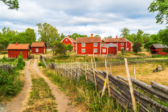 The historic village of Stensjo in Smaland, Sweden, as seen from a nearby country road.