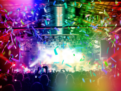 Rainbow coloured nightclub with people partying and dancing