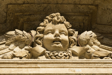 Carved cherub detail on an historic building