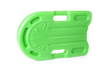 Green safety plastic swim board in hand  on the white