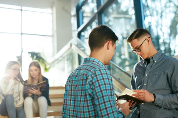Students Learning, Reading Book In College
