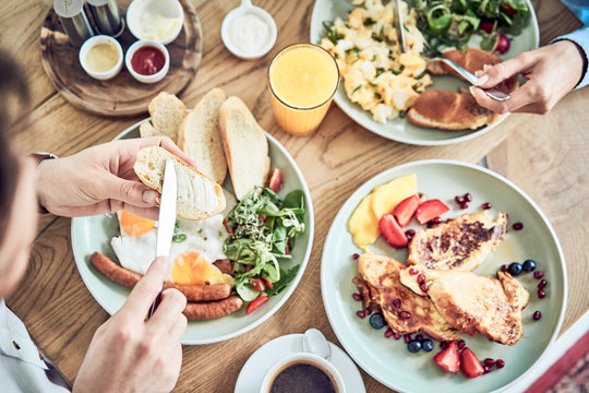 Close up of couple having healthy breakfast in restaurant together