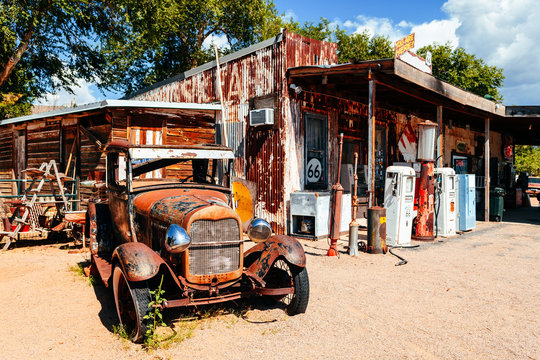 abandoned retro car in Route 66 gas station, Arizona, Usa