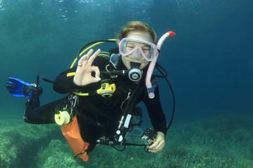 Female scuba diver okay signal