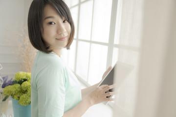 comfortable 20s girl reading book in indoor