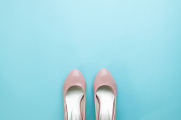 Pair of pastel pink woman's shoes on turquoise color background, Fashion minimal concept