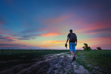 man on a wheat field / photographer in search of spring sunset plot