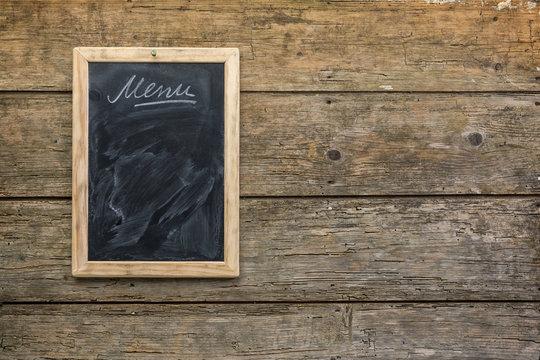 Menu chalkboard on rustic wooden wall