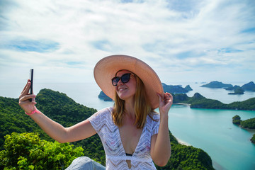 Female Traveler Taking Selfie with Tropical Islands at Angthong National Marine Park in Thailand