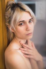 Nude woman looking at camera