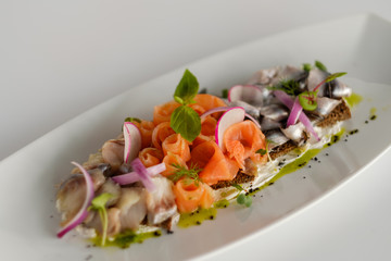 Fish mix with vegetables. Cold appetizer