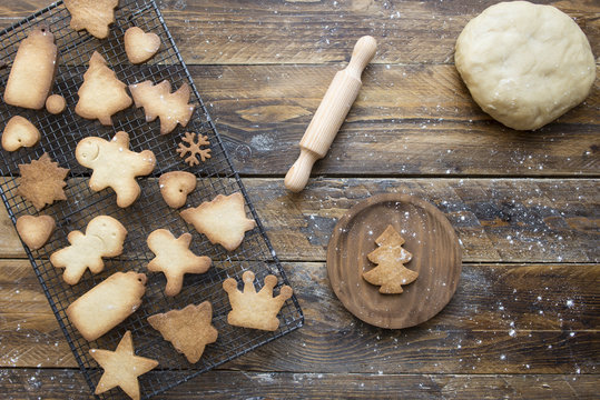 Various home-baked gingerbread cookies on cooling grid and dough ball