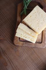 cheese cut on a wooden background