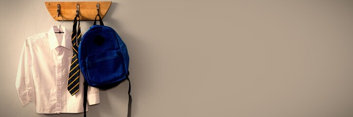 School uniform and schoolbag hanging on hook Wall mural