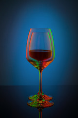 Coloful wineglass on table.