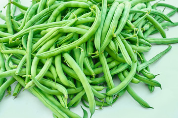 Pile of green beans, photographed on blurred background, natural fresh product
