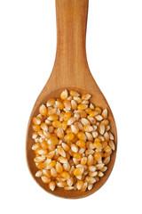 Corn kernel in a wooden spoon
