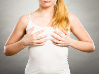 Woman holding hands on her breast