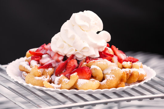 Funnel Cake with Strawberries and Whipped Cream