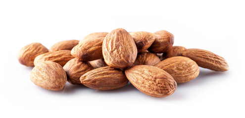 whole almond kernels lie a handful on a white background