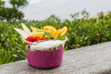 Acai bowl takeaway with fresh fruit and mint