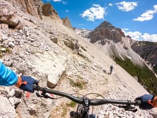 Three men mountain biking, Fanes-Sennes-Braies National Park, Dolomites, Trentino, South Tyrol, Italy