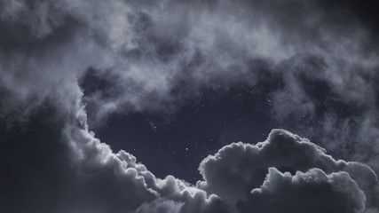 Cloudy night skly with stars
