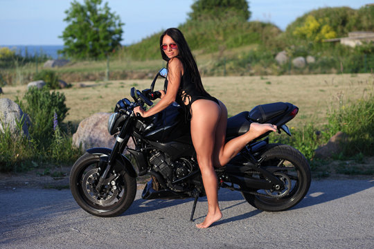 sexy girl in swimsuit posing with motorcycle