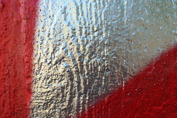 graffiti texture on wooden material in silver red. backdrop