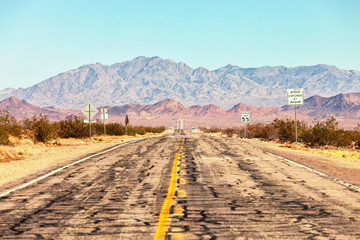 Fotobehang Route 66 Route 66 crossing the Mojave Desert (near Amboy), California, United States .