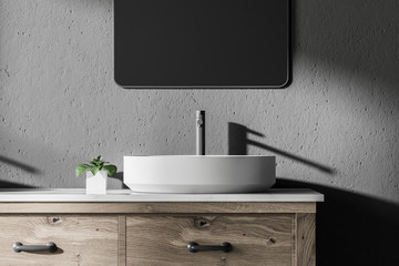 Vessel sink in a gray bathroom