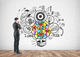 Thoughtful businessman looking good idea sketch