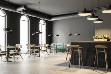 Industrial style bar corner, green sofas