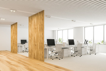 White and wooden open plan office corner