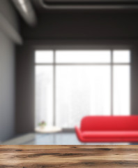 Industrial style living room, red sofa blur